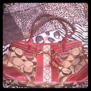 Well worn Coach bag signature satchel with tassel